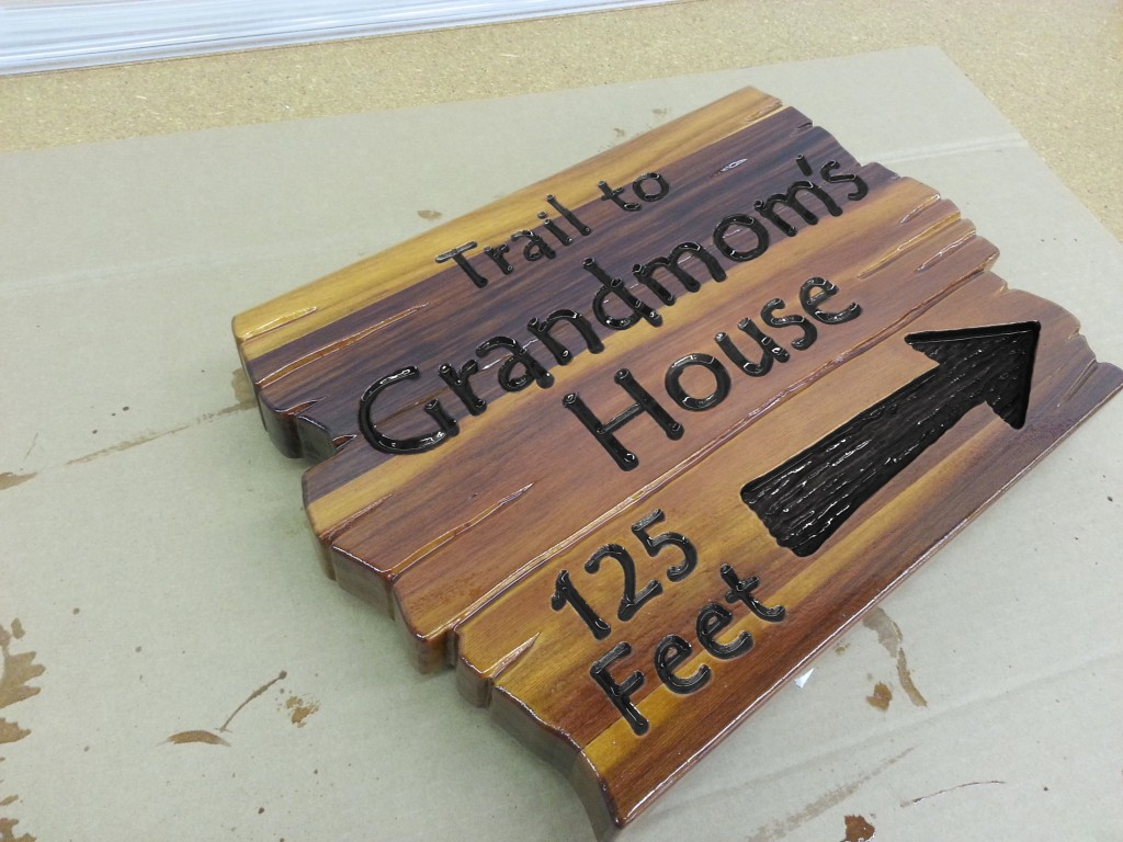 Carved Wooden House Sign